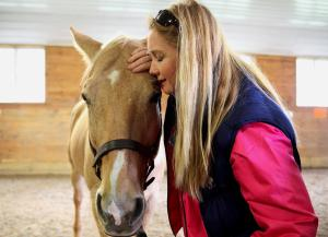 Veteran Eadyie Davis of Marlborough shared a quiet moment with therapy horse Creek. ~ Wendy Maeda/Globe Staff